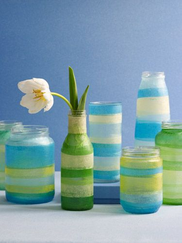 "Fun spring craft! Decorate your old bottles and jars with tissue paper to make vases!    Apply Mod Podge around the bottom 1"" of the jar and lay a strip of paper over it, gently smoothing out any wrinkles or bubbles. Continue in this fashion, overlapping paper edges slightly, until the jar is covered.    Coat the covered jar with 1 or 2 layers of Mod Podge, following package directions."