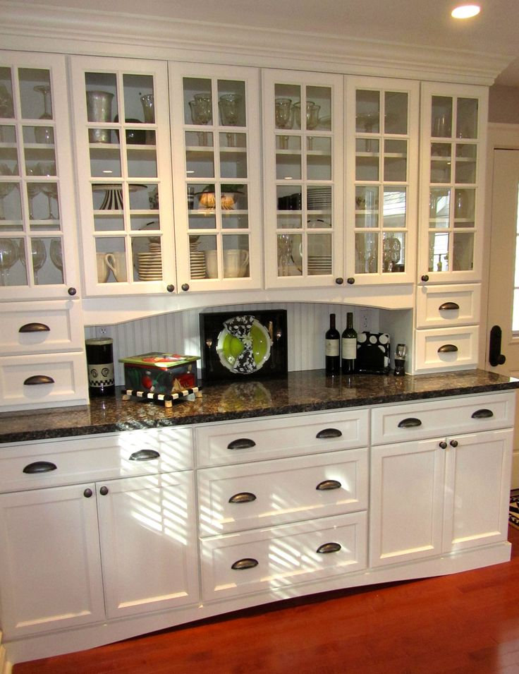 Butler's Pantry. Built in furniture. White. Glass cupboard doors. Use to store china and stemware