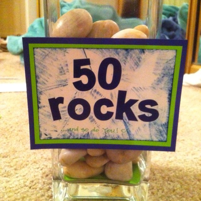 Celebrate that Milestone Birthday in Style.. i would add flowers to the vase and have the rocks around them and then use it as centerpieces