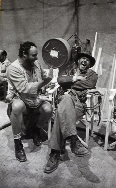 Jonathan Rhys-Davies & Harrison Ford, laughing on set of first Indiana Jones movie.