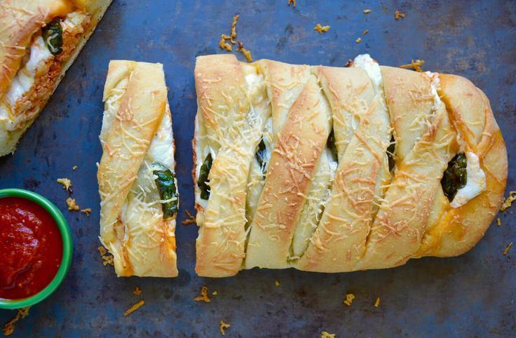 Preheat your oven for an easy, cheesy recipe for chicken stromboli dunked in marinara sauce.