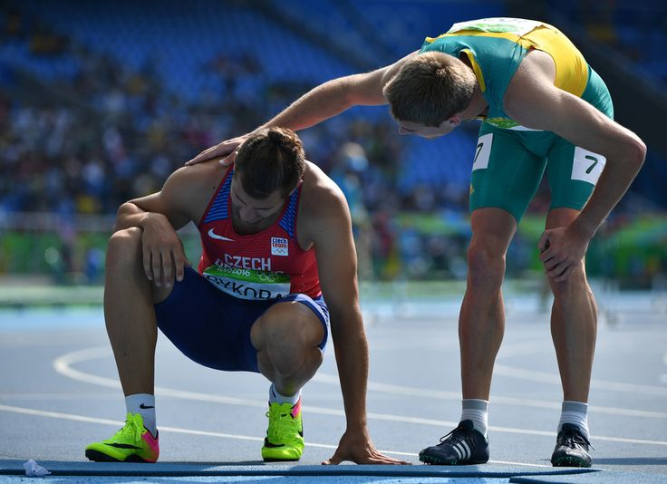 Czech Republic's Jiri Sykora (L) is comforted by Australia's Cedric Dubler after they competed in the Men's Decathlon 110m Hurdles during the athletics event at the Rio 2016 Olympic Games at the Olympic Stadium in Rio de Janeiro on August 18, 2016. / AFP / OLIVIER MORIN