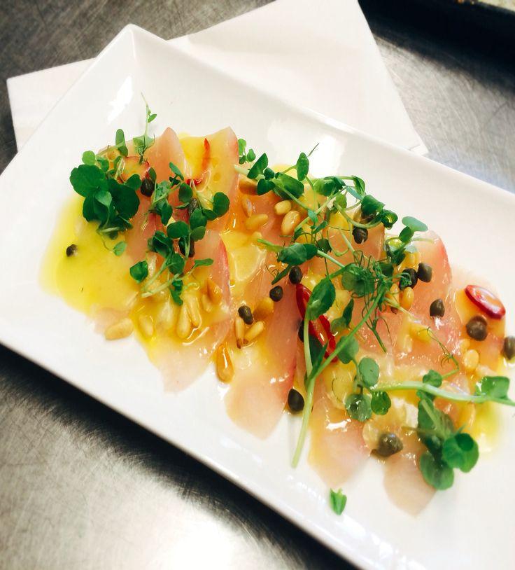 Peaceful bay Kingfish carpaccio with pine nuts, capers, chilli, lemon
