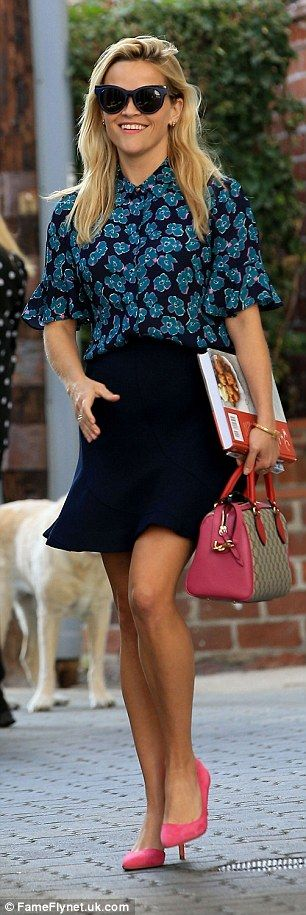 Gorgeous gams:The star stepped out in a navy skirt with a ruffled hemline…
