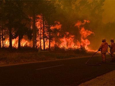 Firefighters defend the Glenmaggie Caravan Park, Victoria, on 18 January, 2013.