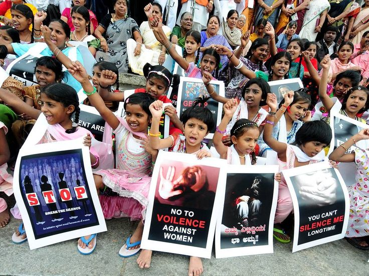 14 November 2014 Members of All India Council of Human Rights a non governmental organisatation and school children's holds placards and shout slogans against the rising crime against children, during a protest in Bangalore, India. On the occassion of India's Children's Day, Demonstrators staged a protest against the increasing crime and sexual abuse against children's in and out of school EPA/JAGADEESH NV