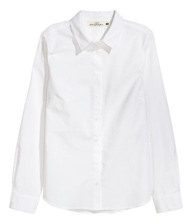 White. Shirt in soft, woven cotton fabric. Turn-down collar, cuffs with buttons, and a rounded hem.