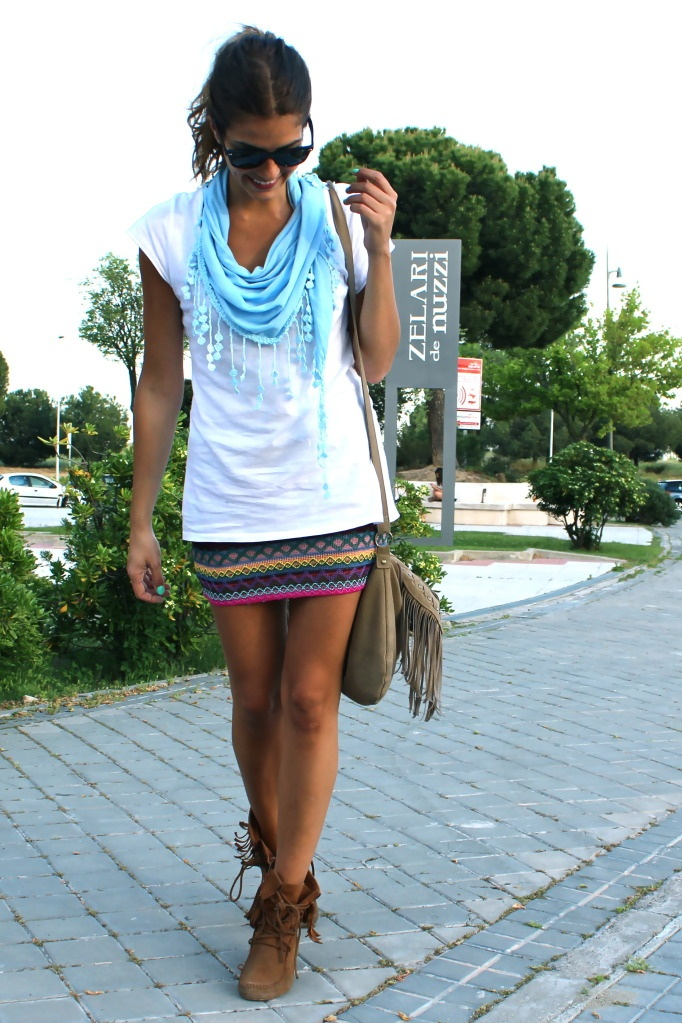 Casual. White tee with a bright scarf and printed skirt.