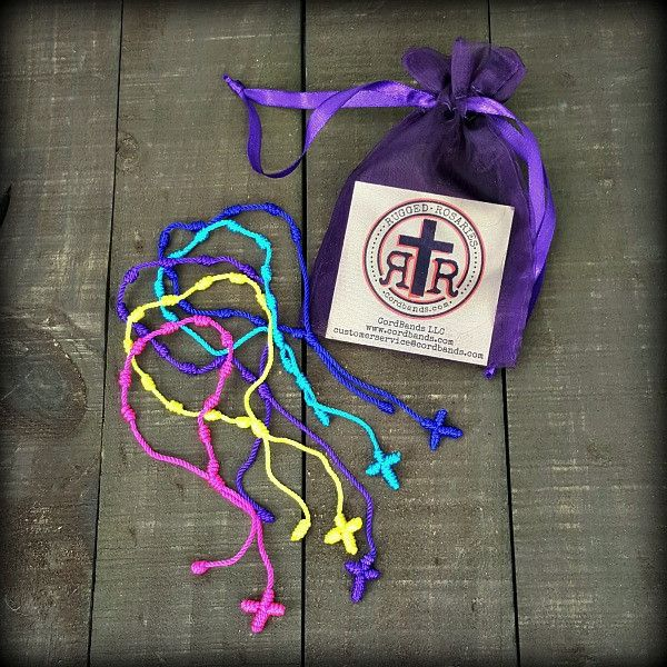 Decenarios - Rosary Friendship Bracelets Pack of 5. Decenarios are cotton cord bracelets tied with ten knots which can be used as Rosaries. In Spanish custom, they are given to celebrate births, first communions, and religious weddings.