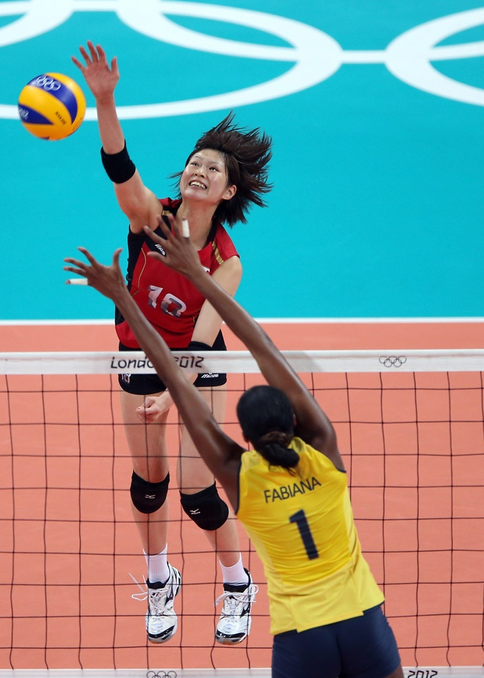 London 2012 - Saori Kimura #18 of Japan spikes the ball as Fabiana Claudino #1 of Brazil defends during the Women's Volleyball semifinal match on Day 13 of the London 2012 Olympics Games at Earls Court on August 9, 2012 in London, England.  Getty