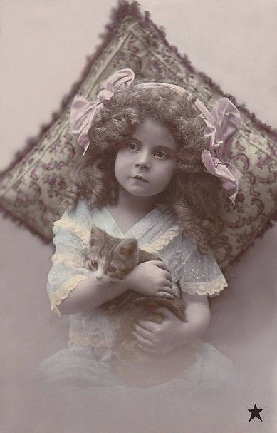 Vintage Postcard - Little girl holding a kitten.