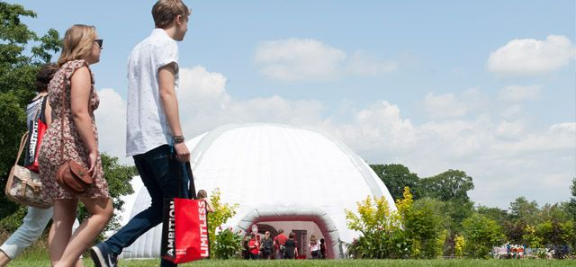 Students walking towards a large white inflatable dome - Reading University Open Day