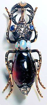 Beetle brooch   gold, garnet, opals, sapphires (Yuri Drobaha).  Again, recent not antique, how I'd love to afford this!