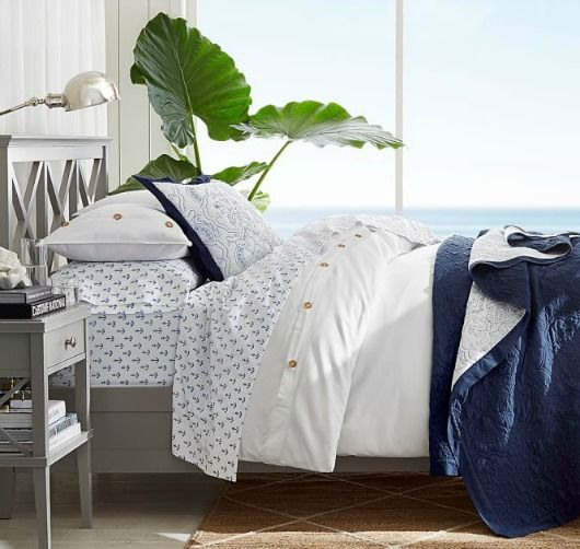 Navy Blue and White Anchor Sheets.... http://www.completely-coastal.com/2017/05/navy-blue-white-stripe-living-room-bed.html