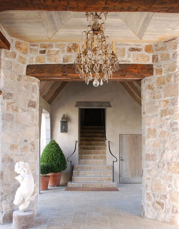 Stone and wood entrance, chandelier, loose the cupid.