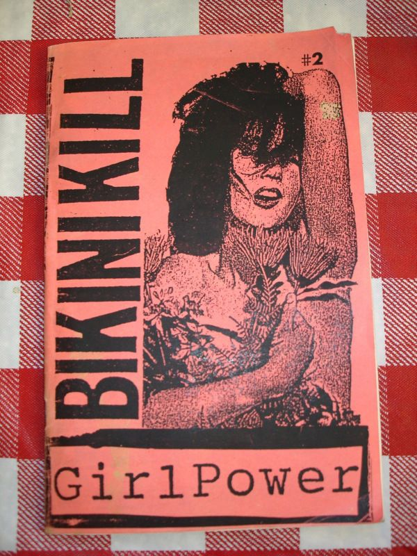The four-person band Bikini Kill was started in 1990 by Tobi Vail and Kathleen Hanna who were the force behind the zine of the same name. Along with Jigsaw, Girl Germs and Riot Grrrl (the zine), this zine was instrumental in initiating the Riot Grrrl movement.