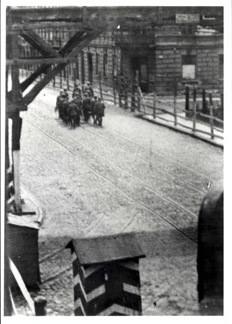 Lodz, Poland, 1943, German policemen changing guard at the entrance to the ghetto.