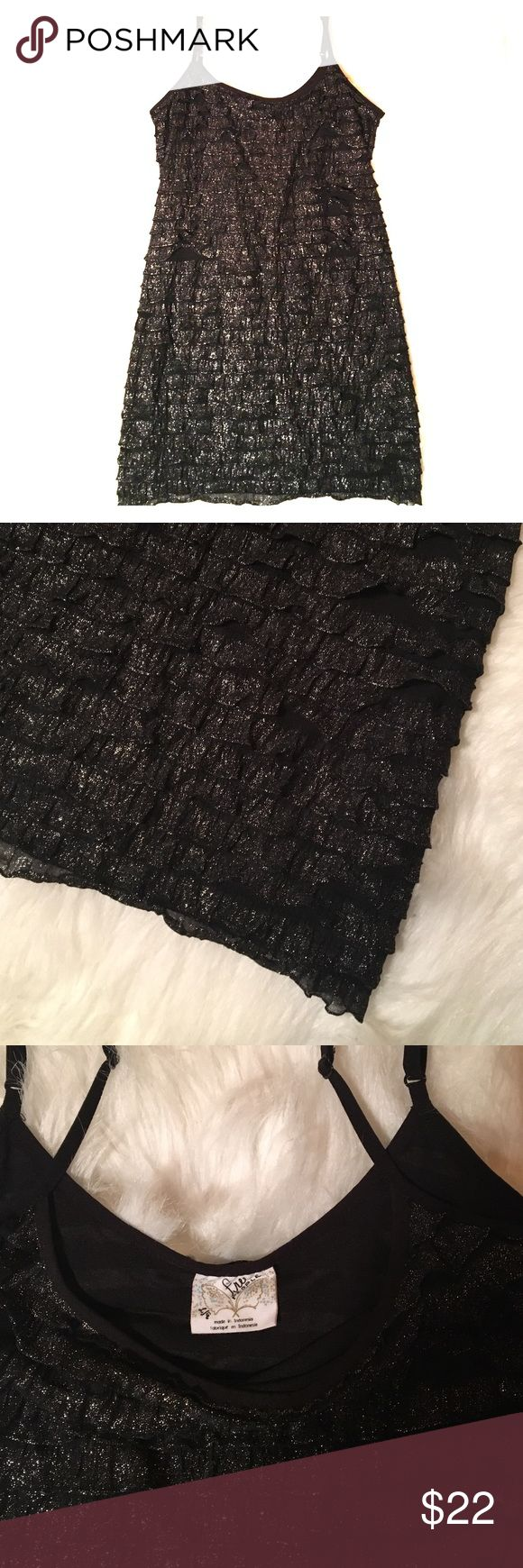 """Free People Bodycon Black Shimmer Dress Ruffle L Free People Bodycon Black Shimmer Dress Ruffle Large. Shimmery metallic silver on black. See through material under ruffles. 93% polyester 7% spandex. Spaghetti straps. Multi use. Tank, mini dress, neglige... so sexy. Measures approx 14"""" underarm to underarm, 28 1/2"""" long. Adjustable straps. Great condition. Free People Dresses Mini"""