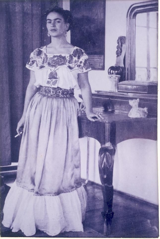 Kahlo smoking. Demure and more lovely than her self ...