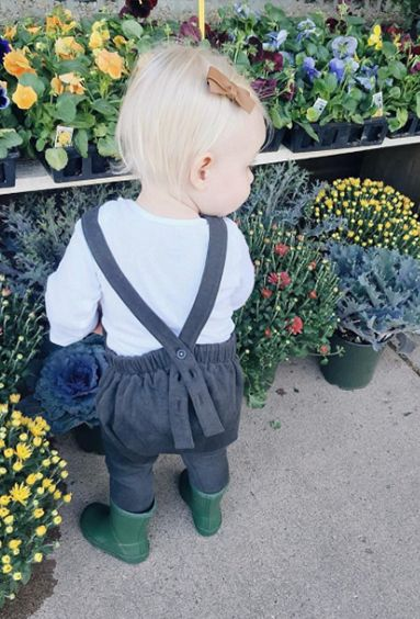 Mini minimalist out flower shopping with mama. Stylish little blondie with a cute neutral bow and black and white overalls outfit with rain boots. Organic salopette from Noble Carriage's Gray Label Collection, boho hipster in training so cute so on trend little bebe.