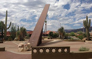 One of the world's largest sundials anchors a colorful and eclectic desert garden in Carefree. This time-telling sculpture measures 90 feet in diameter and points to the North Star. The metal gnomon (which casts the shadow on the sundial) stands 35 feet and stretches 62 feet.