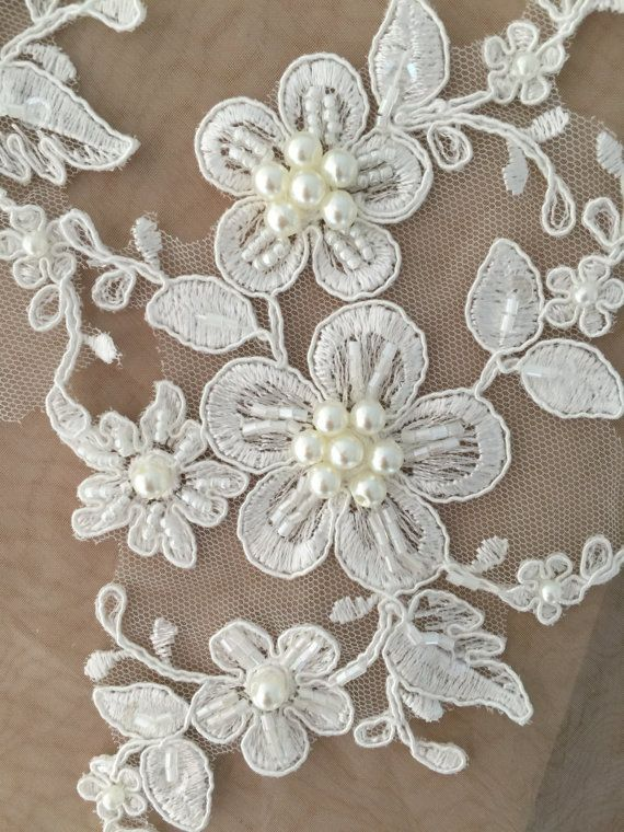 Lovely ivory alencon lace applique pair with pearls beaded , your great choice for wedding accessories, bridal garters making, wedding belt , bridal sash decors Size is about 10 x 12 cm Price is for one pair as pictured, more in stock .   Limited stock .   my shop link:  http://www.etsy.com/shop/lacetime  Thank for shopping and have a nice day forever !   ----------------------------****-----****--------------------- ------------------------***---------------***-----------...