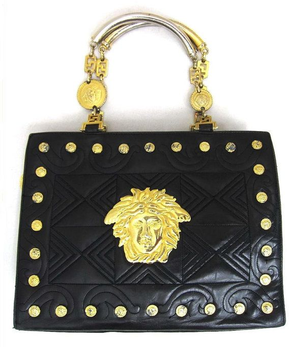 Vintage Gianni Versace Black Leather Tote Bag With Golden Medusa Charms And Gold Tone