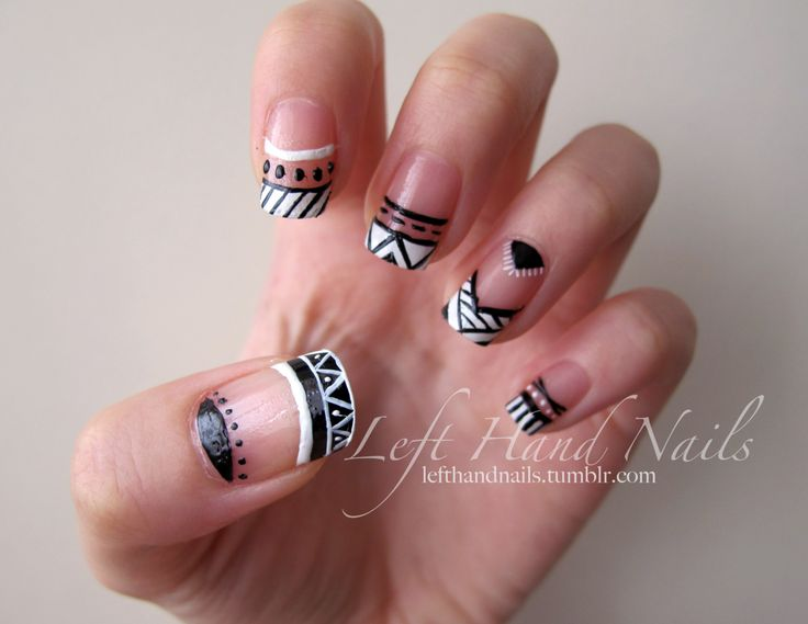 Negative space black and white funky french tips in Aztec / tribal nail art design