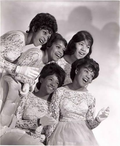 """The Crystals  The Crystals, a singing group from the New York City area, was one of the most successful girl groups of the early 1960s, best remembered for the hit singles """"He's A Rebel"""", """"Da Doo Ron Ron"""" and """"Then He Kissed Me"""". [source: wikipedia]"""