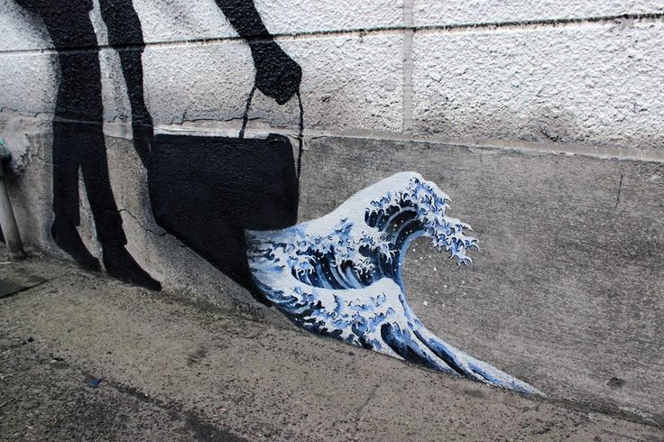 """""""Everyone is an artist"""" (june 2015) by Spanish street artist Pejac in Kawasaki City, Kanagawa, Japan. A silhouette of a cleaning lady pouring out a bucket of Hokusai's iconic """"The Great Wave Off Kanagawa."""""""