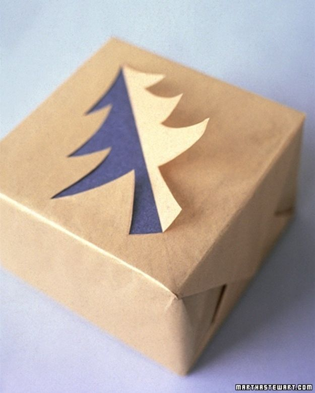 Cut out half a tree on plain paper for some multidimensional interest. | 23 Tricks To Take The Stress Out Of Wrapping Gifts
