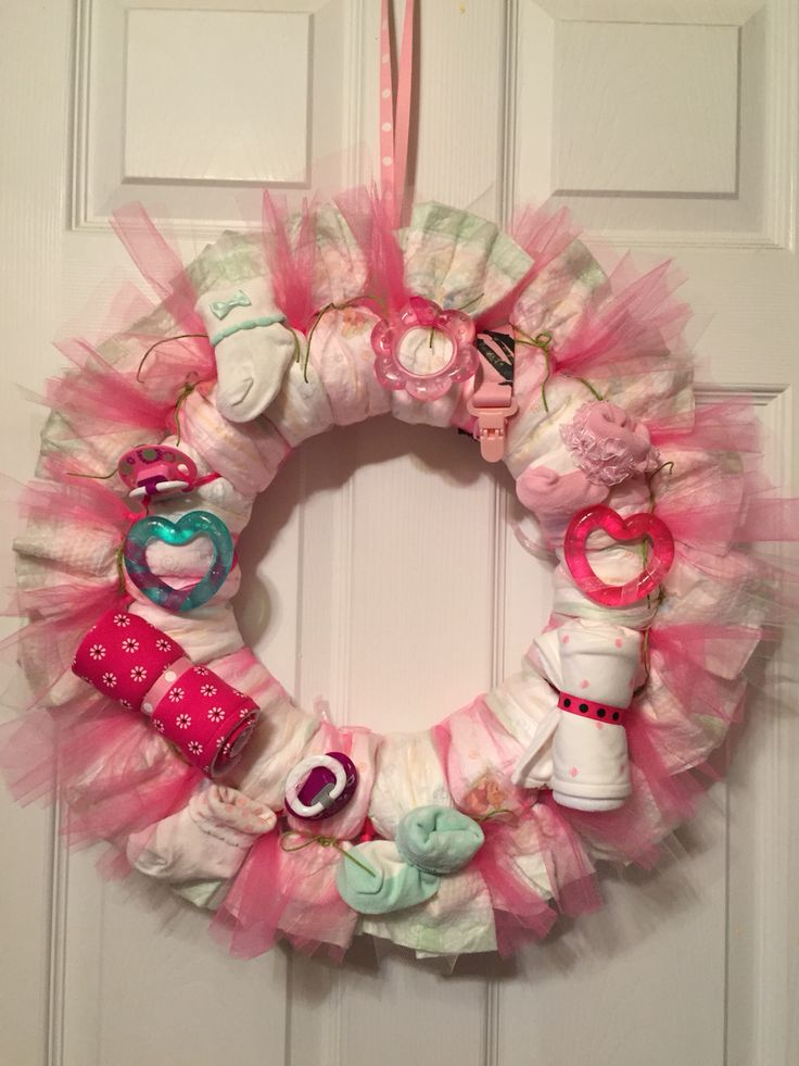 Diaper wreath for a baby girl. Great for decoration AND gift for baby shower!