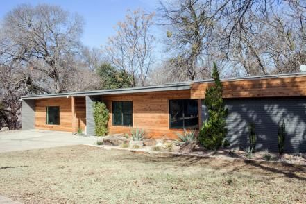 Love the look of pine paneling? Try it on your home's exterior, like Chip and Joanna did on this midcentury modern-style home.