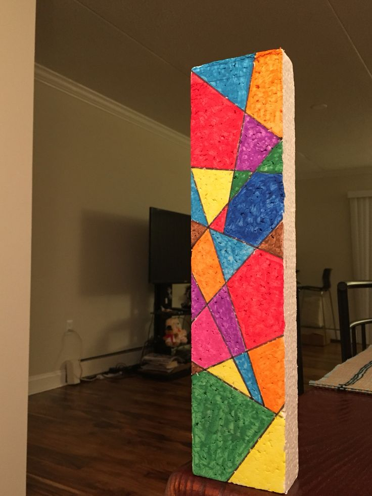 It's not as gigantic as it looks in the image. It's about a foot long waste piece of thermocol with we painted by using the design of abstract shapes. No varnish or polish has been used.  A note of caution: Use only water colors with thermocol. Never use acrylic or oil colors, nail polish, dyes or any other heavy chemical material as they would burn thermocol.