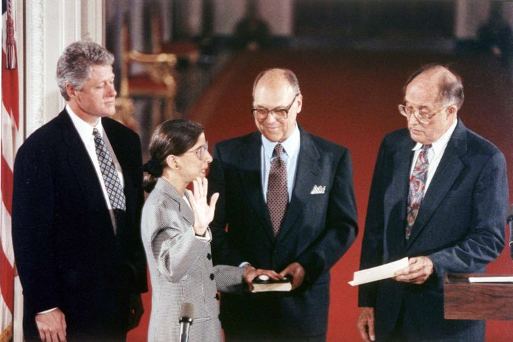 <b>August 10, 1993</b> Justice Ruth Bader Ginsburg is sworn in as an Associate Justice of the Supreme Court. From left to right stand President Bill Clinton, Justice Ruth Bader Ginsburg, Martin Ginsburg, and Chief Justice William Rehnquist.