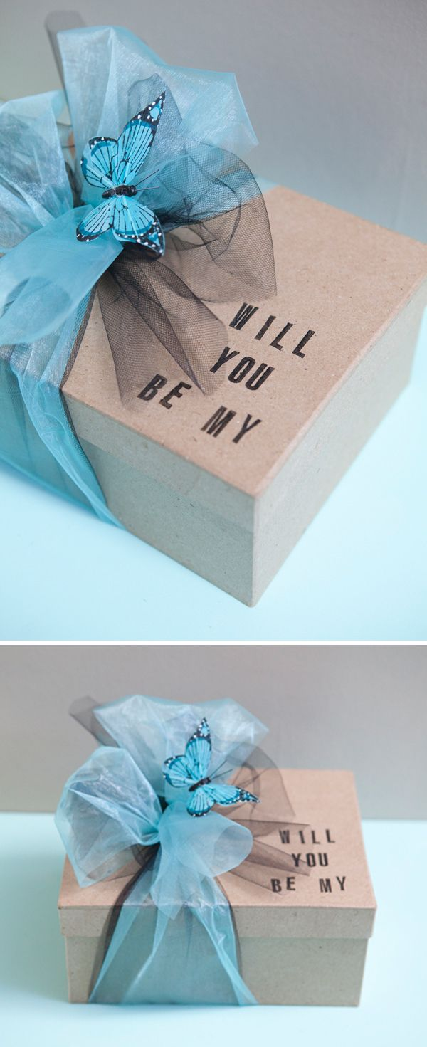 An adorable idea for asking someone to be my bride's maid or maid of honor. It has a tank top, small bottle of champagne, a giant faux diamond, and a bottle opener in it. So Cute!