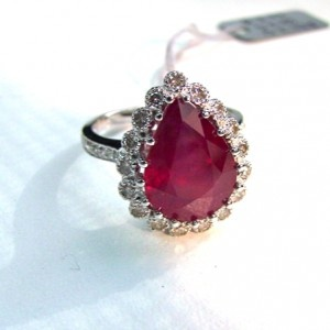 Teardrop ruby surrounded by small diamonds