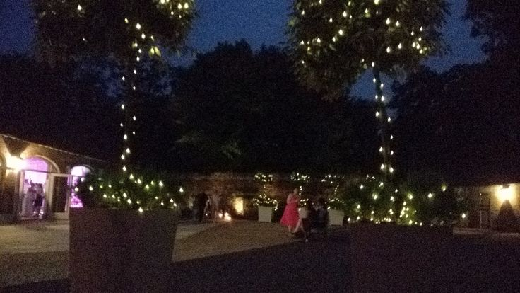 @Dorneycourt  Their beautiful bay trees have be wrapped in warm white fairy lights to provide gentle lighting to the Court Yard. #Fairylights #Outdoorlighting #barnwedding