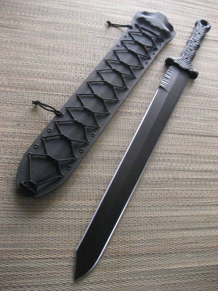"Miller Bros. Blades Custom Made M-16 Tactical  Sword. 24"" Blade, Double Handed, Kydex sheath.  This sword has a custom tip profile and jimping on the spine near the handle. http://www.millerbrosblades.com/"