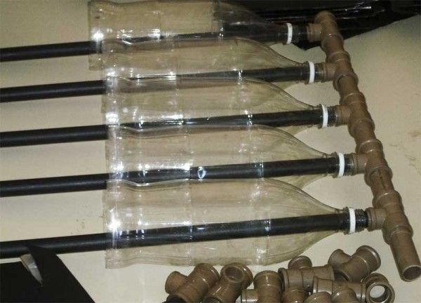 make a solar water heater with plastic bottles