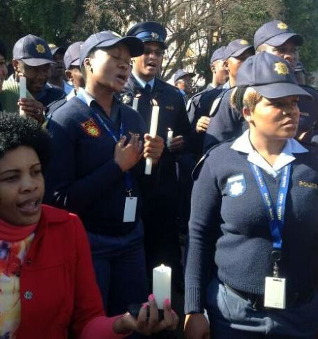 SAPS sang beautifully for Madiba outside the PTA hospital. Picture: Chriselda Lewis, SABC TV News journalist