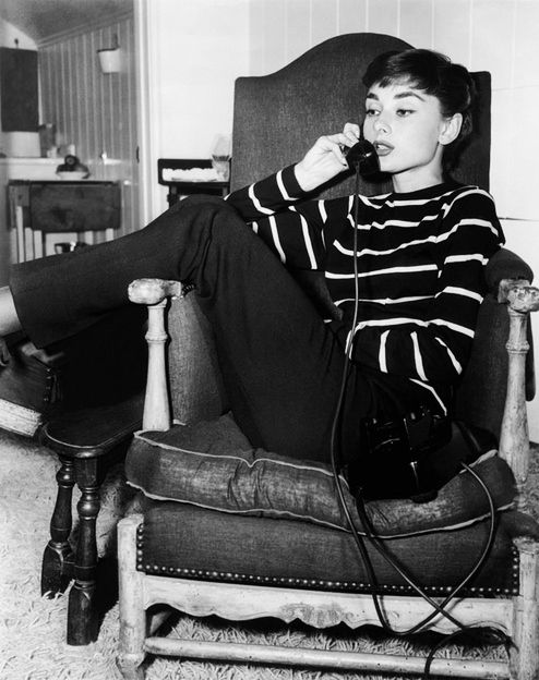 Audrey Hepburn on the phone at her rented Los Angeles apartment during the production of Sabrina, 1953.