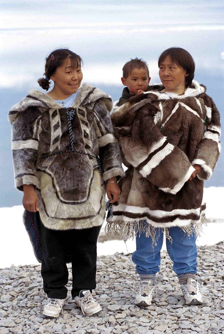INUIT Iglulik women wearing amauti in 1999. - The amauti (also amaut or amautik, plural amautiit) is the parka worn by Inuit women of the eastern Canadian arctic.