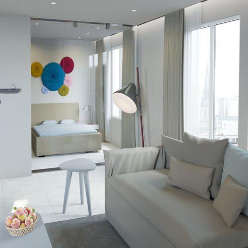 Apartament w Warszawie w stylu scandi: jasne kolory, przestronne wnętrza, minimalistyczne dodatki.