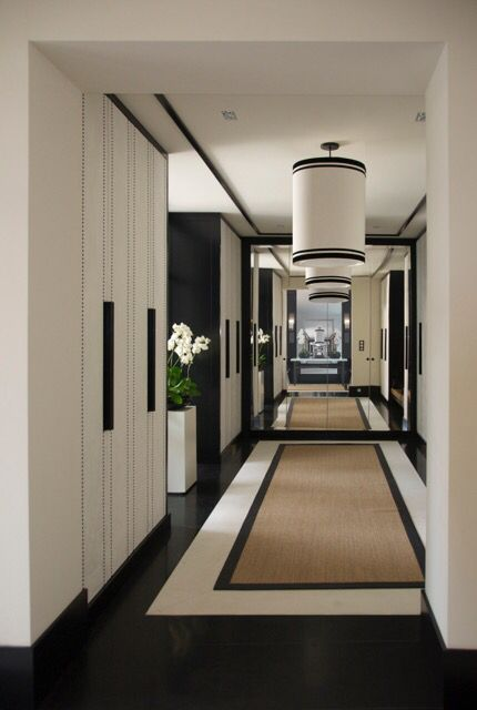 Stunning black & white hallway & foyer. The addition of a full wall mirror elevates it even more. Thinking some variation of this for our hall? Rug? Forget the light fixtures -- but if the bathroom door at end had an elegant mirrored face? I'm dreaming and scheming