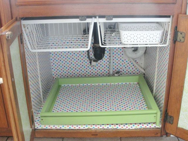 Under the Sink Makeover - Kitchen Cabinet Makeover Ideas - hanging baskets inside cabinets, for cloths