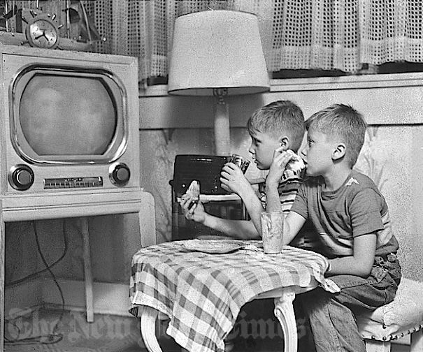 +~+~ Vintage Photograph ~+~+ TV- Dinners in the 1950's Look how close they're sitting to the screen!