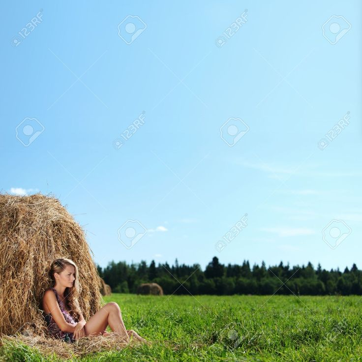 Portrait Of A Girl Next To A Stack Of Hay Under The Blue Sky Stock Photo, Picture And Royalty Free Image. Image 10940898.