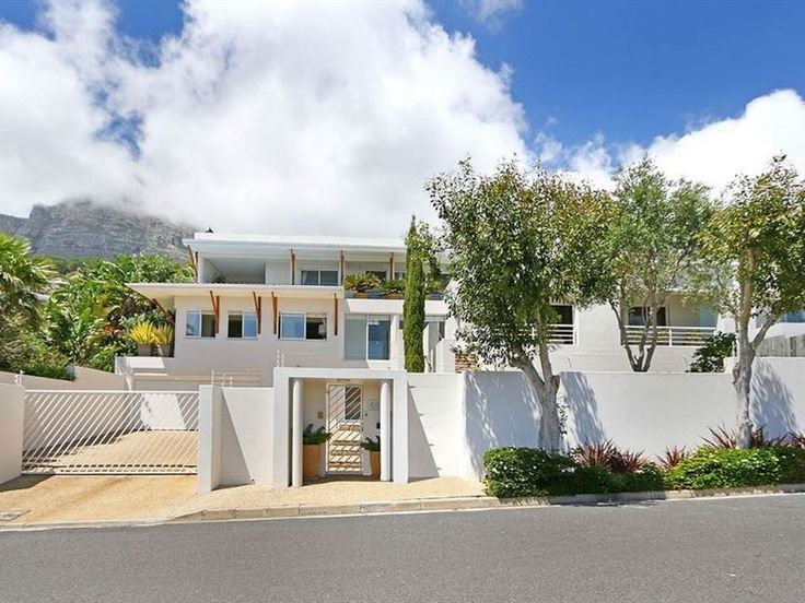 Saints Villa - Saints Villa is located in the upmarket suburb named Camps Bay in Cape Town. This chic modern villa can accommodate up to 13 guests and features two fully equipped kitchens, two dining areas, two open-plan ... #weekendgetaways #campsbay #capetowncentral #southafrica