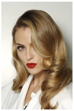 We love these vintage curls and bold lip color. And it would be so easy to recreate with a large barrel curling iron and your favorite red lip stick!